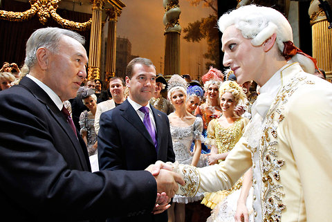 "David Hallberg, right, is greeted by President Nursultan Nazarbayev of Kazakhstan, left, and President Dmitry Medvedev of Russia, center, after the Nov. 18 performance of ""Sleeping Beauty"" at the Bolshoi Theater in Moscow. Dmitry Astakhov/RIA Novosti Kremlin, via Associated Press"