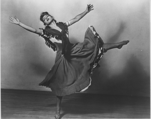 "Sophie Maslow in her 1942 work Folksay. A collaboration with Woody Guthrie, incorporating American folk songs and the Carl Sandburg text ""The People, Yes,"" Folksaywas praised by critic John Martin as ""one of the most beautiful and genuine works in the whole range of contemporary dance."" (Photograph from the archives of the American Dance Festival.)"