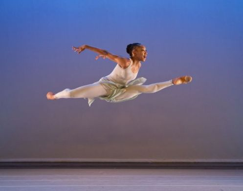 Alvin Ailey American Dance Theater's Demetia Hopkins in Alvin Ailey's The River.  Photo by Paul Kolnik