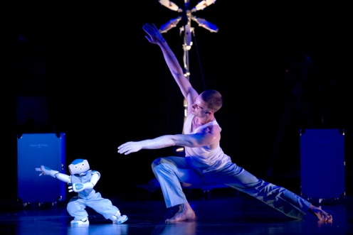 """Gaël Rougegrez performing with an NAO robot in """"Robot: A Show by Blanca Li"""" at the Brooklyn Academy of Music, Photo: ©Laurent Philippe"""